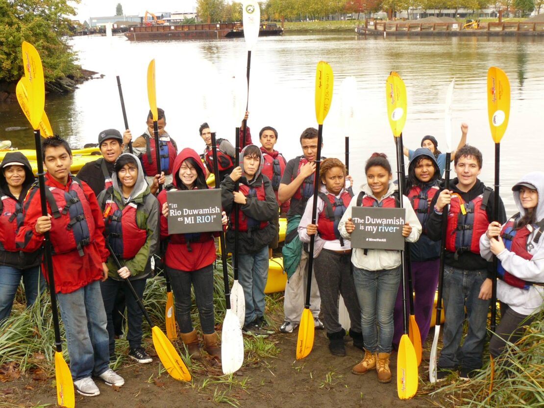 Youth in front of Duwamish River